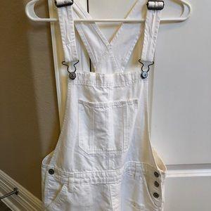 White distressed denim A&F overalls - shorts
